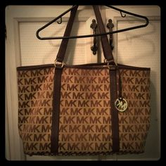 Signature MK tote This is a LARGE Authentic Michael Kors tote. Could be used for an overnight bag or perfect if you love larger handbags. Has some staining on the interior and straps are considered good but not perfect. Bag new retails for $398.00 you won't be disappointed with this bag. MICHAEL Michael Kors Bags Totes
