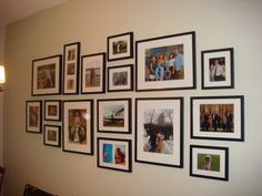 "This family gallery wall uses what I call a horizon line (or ""equator"", I can't decide) method – growing the display above and below a level line, and to the sides... ElizabethAnneDesigns.com"