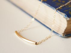 Gold curved bar necklace14k gold filled bar and by NoaNoaJewelry, $25.00