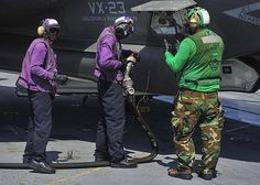 Sailors finish refueling an F-35C Lightning II carrier variant, assigned to the Salty Dogs of Air Test and Evaluation Squadron (VX) 23, on the flight deck of the aircraft carrier USS George Washington (CVN 73).