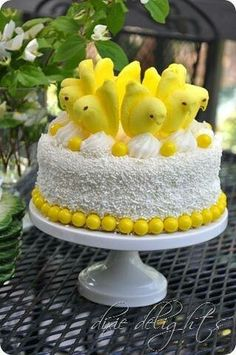 Easter Cake Idea ~ simply add Peeps and yellow gumballs to a store bought cake. Easter Cake Idea ~ simply add Peeps and yellow gumballs to a store bought cake. I would make a white cake with white icing and coconut for this cake! Peeps Recipes, Easter Recipes, Hoppy Easter, Easter Eggs, Easter Food, Easter Decor, Easter Bunny Cake, Easter Cupcakes, Easter Stuff