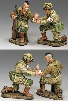 World War II U.S. 82nd Airborne DD247 82nd Airborne Medic Tending to Paratrooper - Made by King and Country Military Miniatures and Models. Factory made, hand assembled, painted and boxed in a padded decorative box. Excellent gift for the enthusiast.