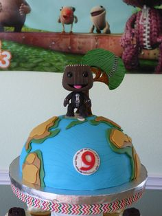 Little Big Planet theme birthday cake. Chocolate cake with Sackboy doll figure, tree and map were made of fondant.