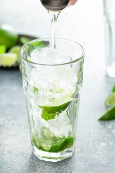 This is the best Mojito recipe, with a quick homemade mojito simple syrup to intensify the flavor! Plus, all my tips on how to make Mojitos for a crowd! #Mojito #MojitoRecipe #Howtomakeamojito #Cocktail #Cocktailrecipes #cocktails #rumcocktails Bar Drinks, Yummy Drinks, Alcoholic Drinks, Coconut Mojito, Pineapple Coconut, Jello Shot Recipes, Alcohol Drink Recipes, Keto Cocktails, Classic Cocktails