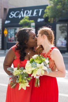 Lesbian Wedding: red gowns; #interraciallesbians #qwocwedding #nonwhiteweddingdress