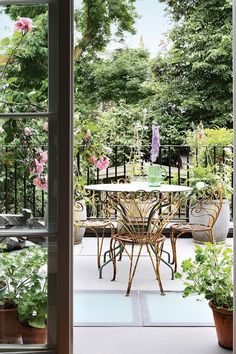 "[i]Wrought-iron chairs and a table provide a place to take in the view on the roof terrace. [/i] Like this? Then you'll love [link url=""http://www.houseandgarden.co.uk/outdoor-spaces/features/garden-patio-and-decking-ideas""]15 Garden Patio and Decking Ideas[/link]"