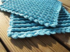 Tyyne potholder - Worked in classic granny clusters, interesting method of folding over & working through the 1st layer's spaces to make a double thickness  . . . .   ღTrish W ~ http://www.pinterest.com/trishw/  . . . .   #crochet