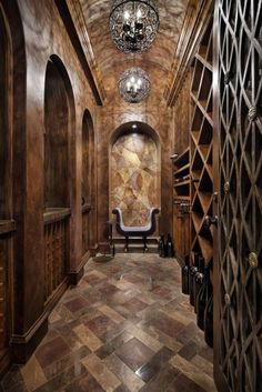 Dark and gorgeous Jauregui Architectures wine cellar