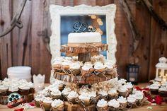 Wooden tree cake stand + small cake + cupcakes!   Photo by Rad Red Creative www.radredcreative.com #makeyourweddingrad #weddingphotography #bouquet #redbouquet #tampaphotography #tampaweddingphotography #tampawedding #tampaphoto #cake #weddingcake #cupcakes #weddingcupcakes #wishingwellbarn #countrywedding #rusticwedding