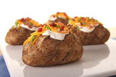 """Grilled """"Baked"""" Potatoes recipe - We'll admit it, we can't stand the heat. So we're taking baked potatoes out of the kitchen for the summer, with fluffy insides and skins so crisp you'll never miss the oven. #ForDad"""