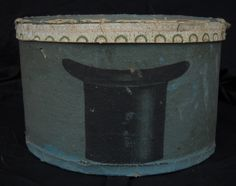 A mid 19th century wallpaper covered hat box or bandbox made by S. A. Brower & Co.'s Factory which was located on Hanover St. in Boston, Massachusetts.  The label is on the under side of the cover.  The pasteboard box has great decoration featuring a top hat on the front and the back.