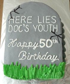 A birthday cake shaped like a tombstone is a proper way to mourn.  See more 50th birthday party themes and party ideas at www.one-stop-party-ideas.com