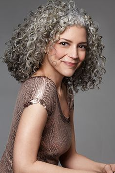 I'm still a youngin' (kinda!) but I've been sprouting gray hairs since I was 13. I also have curly hair similar to this lady's...I'll be honest, I don't know what to do with it, but I'd love to meet someone that could help! I have no qualms with keeping the salt & peppa.. it's natural. :)