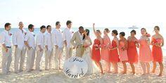 Beach destination wedding in Grand Cayman - shades of coral bridesmaids shot by aaronrebarchek.com