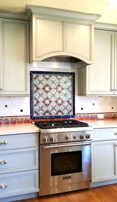 Ole Hanson Kitchen remodel with Mexican tile backsplash by kristiblackdesigns.com