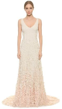 Graduated appliqués create an ombré effect on this stunning gown, offering a textured take on the column silhouette.