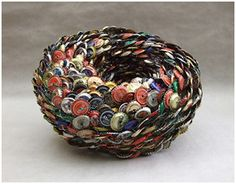 Even waste can be beautiful and useful. A bowl made out of bottle caps.