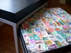 Craftster user Volcano revamped one of her IKEA side tables by decoupaging it with colorful postage stamps, turning a run-of-the-mill piece of furniture into an offbeat showpiece. Link.