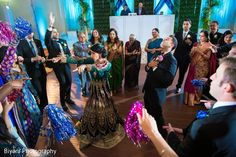 Indian bride and groom dancing with guests http://www.maharaniweddings.com/gallery/photo/131967