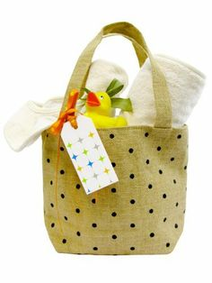 Terry Gift Tote in Natural by American Terry. $42.00. Theme: Ducks. Primary Color: Neutral & Muted Colors. Design Elements: Dots & Swirls. Non Personalized: Quick Ship Personalized: 2-4 WeeksThe Terry Gift Tote makes the perfect gift for a baby shower! All the goodies come in a cute polka dot gift bag, the perfect gift presentation!Baby Gift Tote Includes:1 organic baby hooded towel1 organic baby bib1 organic white cotton washcloth1 rubber ducky1 mini polka dot gift tote1 h...