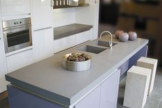 Granite worktops Exeter and Quartz worktops Exeter are arguably the two most popular choices. Quartz worktops are stain resistant. Quartz worktops have become the fastest growing and most popular type of solid kitchen Worktops. Quartz Countertops Colors, Granite Kitchen Counters, Granite Worktops, Kitchen Worktops, Worktops Uk, Caesarstone Concrete, Concrete Countertops, Kitchen Tops, New Kitchen