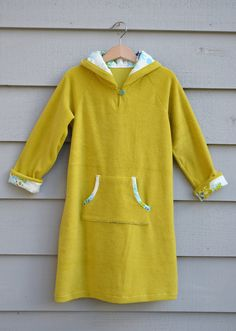 LiEr from ikat bag shares a free pattern and tutorial on her blog for making a swim cover-up tunic for little girls. The long-sleeved and hoodedcover-ups are made from a terry cloth and have raglan sleeves. The pattern is in a size 5-6, but you can adjust it up or down as needed. Get the tutorial.