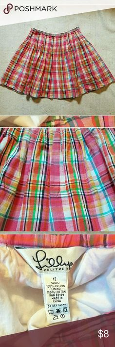 Girl's skirt Beyond adorable Lilly Pulitzer skirt. Bought for my daughter off posh, and so disappointed it did not fit. Elastic in waist, and runs tts. Beautiful color combination in the plaid. I so wish it had fit because it is so pretty. Lilly Pulitzer Bottoms Skirts