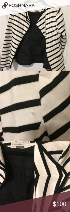 Anthropologie white/black striped blazer Anthropologie/Cartonnier blazer. Has a dynamic white/black striped pattern. Black eyelet lining. Lapels fold back, and the back has great cut. Small snag behind the left lapel. Anthropologie Jackets & Coats