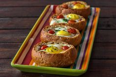Eggs in a Basket...crusty round dinner rolls, eggs, bacon, bocconcino cheese, cherry tomatoes, chives