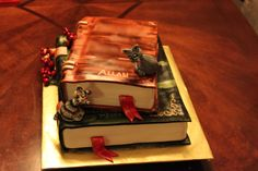 stacked book cake - Very specific cake order, literature themed, cats that looked like the customers actual cats, with a Christmas element (for a Christmas b-day). Made with fondant and gum-tex. Had to blur out the top title per the customer.
