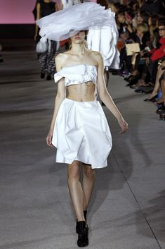 See the complete John Galliano Spring 2013 Ready-to-Wear collection. Model: Esther Heesch (Next)