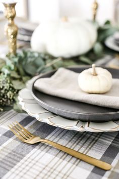 Neutral Low-Key Thanksgiving Tablescape | blesserhouse.com - A neutral low-key Thanksgiving tablescape that is simple and inexpensive to recreate using plaid fabric, white pumpkins, eucalyptus, and brass. #thanksgiving #tablescape