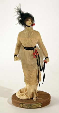 Doll  Date: 1907 Culture: French Medium: silk Dimensions: Height: 12 1/2 in. (31.8 cm) Credit Line: Gift of Mrs. Louis K. Anspacher, 1949 Accession Number: C.I.49.53.2