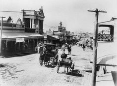 Outside the Prince of Wales Hotel on Mosman Street, Charters Towers, Queensland, ca. 1896 - Daily horsedrawn buggies and wagons in the main street of Charters Towers.