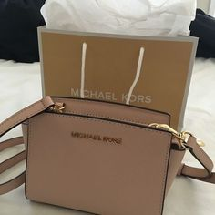 NWT Michael Kors Selma Mini NWT Michael Kors Selma Mini in Ballet (pale pink). Never used before. Will come with the tissue and the MK shopping bag. The mini can fit an iPhone 6 , keys, small wallet, lip sticks and any additional small items. Michael Kors Bags Crossbody Bags