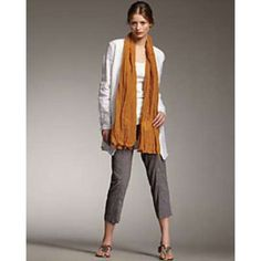"""Eileen Fisher Tangerine Linen washed Scarf NWT Eileen Fisher Tangerine Washed Linen Scarf in a deep orange shade to add a bright, happy pop of color to any look, whether it's warm or cold outside.  Tangerine linen. 74""""L X 25""""W NWT Eileen Fisher Accessories Scarves & Wraps"""