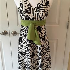 "Ann Taylor Dress, Black & White w/ Green Sash, 2P Black & white dress. Olive green sash can be tied in front or back. Previously worn once. Size 2 petite. Length 35"", Bust 30"", Waist 27"". Tag with fabric content was removed but feels like polyester. Excellent condition. Ann Taylor Dresses Midi"