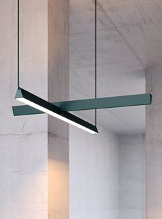 Two linear lights overlap to form this cross-shaped pendant light, created by Guillaume Sasseville.