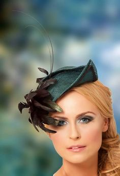 Judy Bentinck Millinery. I have a small navy blue hat without the feather......may have to add a feather now!!