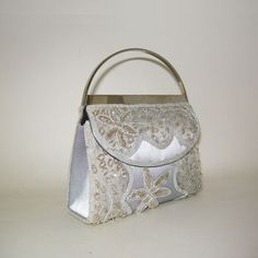 Indian luxury textiles serve to add sparkle to this 60s handbag. Organza and silver beads.