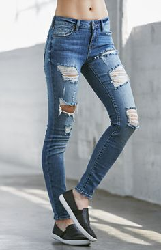 Ripped Mid Rise Skinny Jeans