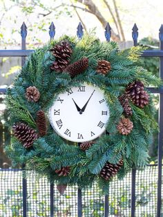 Give wall clocks a #holiday touch by covering the frames with evergreen wreaths. Since the wreath is meant to be the star of the show, simple clocks picked up from discount stores work perfectly. #HolidayHouse