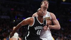 Jason Collins, #46 of the Brooklyn Nets, and Pau Gasol, #16 of the Los Angeles Lakers, battle for position under the net in the second half at Staples Center on Feb. 23, 2014 in L.A. in Collins' first game since announcing he is gay.  (Jeff Gross/Getty Images)