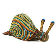 Gorgeous snail woodcarving by Oaxaca artist Alejandro Fabian. Beautiful painting!