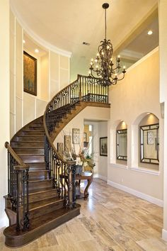 Traditional Staircase with Crown molding, Hardwood floors, High ceiling, Chandelier