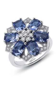 Sterling Silver Blue & White Simulated Diamond Red Carpet Flower Ring. this weirdly reminds me of Fleur Delacour.