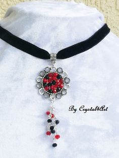 """Red & Black"" handcrafted choker is made of delicate multifaceted glass crystals and black velvet. See more on my online shop https://www.breslo.ro/item/colier-la-baza-gatului-red-black-1842913"