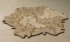 M C Escher butterflies carved from thin plywood by a laser, flooring.