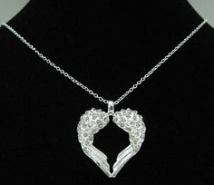 Stunning 925 Silver Heart Wing Necklace Diamond cut give it the sparkle