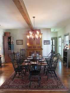 FARMHOUSE – INTERIOR – vintage early american farmhouse showcases raised panel walls, barn wood floor, exposed beamed ceiling, and a simple style for moulding and trim, like in this farmhouse dining room. Colonial Kitchen, Country Kitchen, Primitive Dining Rooms, Primitive Decor, Primitive Furniture, Primitive Country, Cabana, Colonial Furniture, Colonial Chair